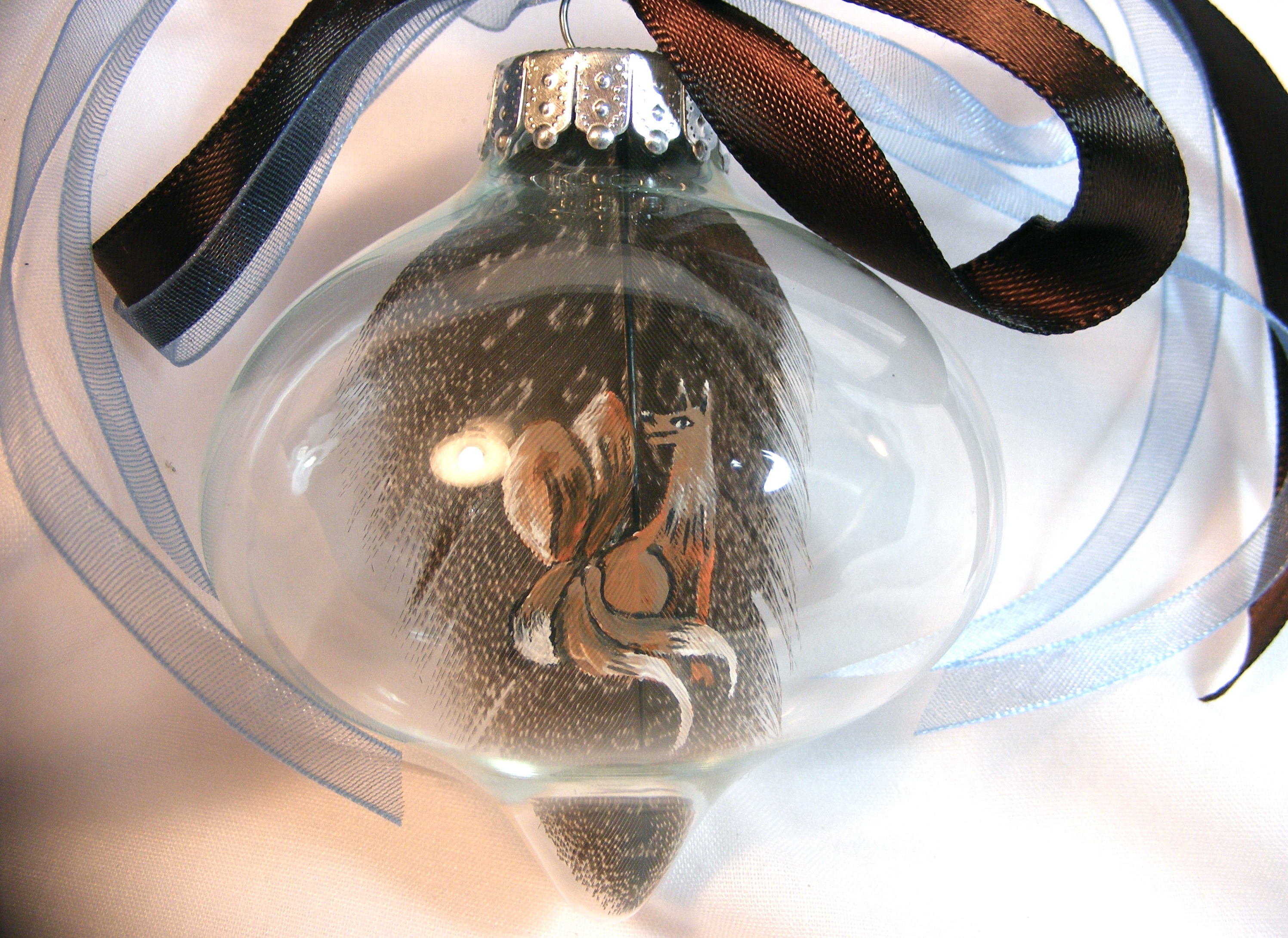 Gobi no Kitsune. Acrylic on guineafowl feather in glass ornament with ribbon.